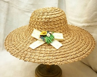 Vintage Italian sun hat in straw of Florence with millinery felt flowers decoration and embroidered ribbon years 1950's, wide brim hat