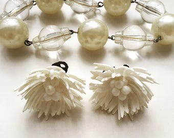 Vintage set of off-white plastic celluloid flower clipped on earrings c.1950 and faux pearl, plastic bead bracelet