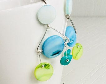 Earrings with blue and green shell beads and silver wire