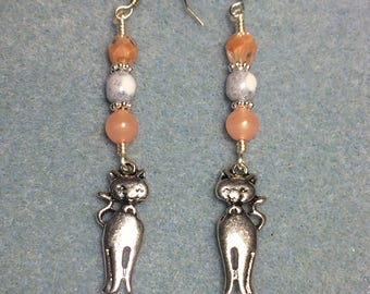 Silver sitting cat charm earrings adorned with peach and grey Czech glass beads.