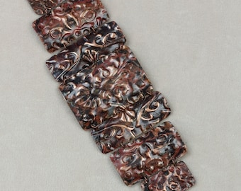 Copper Embossed Black Red Segmented Cuff Style Bracelet