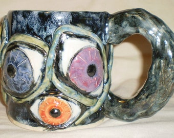 Eye Coffee Cup with Eleven Eyes of Many Colors