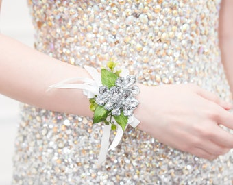 Wedding Corsage Silver, Prom Corsage, Wrist Corsage - Petite Raina Corsage with Green Leaves - Silver Flower Corsage w/ Custom Ribbon & Band