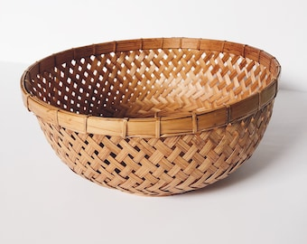 Vintage woven bamboo wall basket
