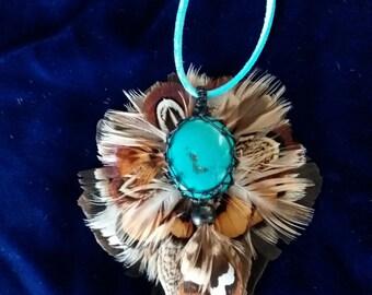 Unique turquoise feather pendant necklace.