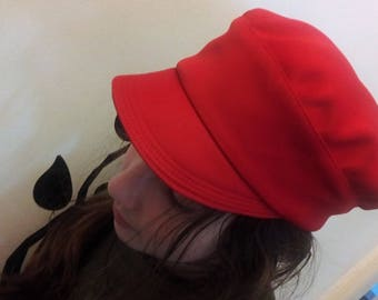 Red newsboy cap