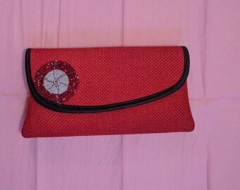 Red clutch bag