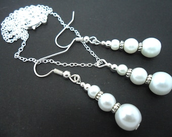 A hand made white glass pearl  necklace and  earring set.