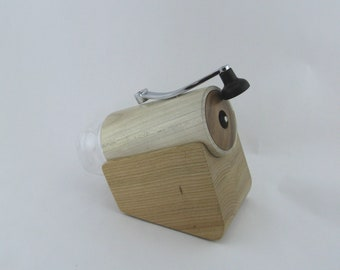 Coffee grinder. Body made from negundo maple, lid from black walnut,base from cherry,  mechanism in ceramic