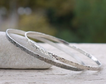 Hammered silver bangles. Hammered bracelets polished and black oxidized, hammered and formed by hand.