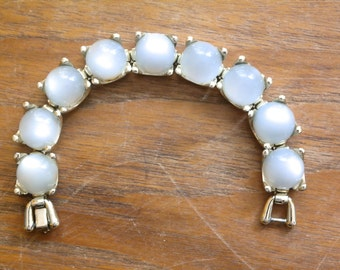 Vintage Thermoset moonglow silvery blue-ish white round lucite cabachons set in silver tone mid century