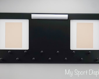 Black Sport Medal display with clamp bib holder and photo frames. White mat.