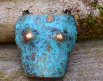 Bust pendant in patinated bronze