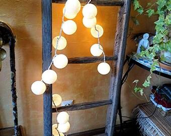 Vintage lamp object wooden ladder with string lights
