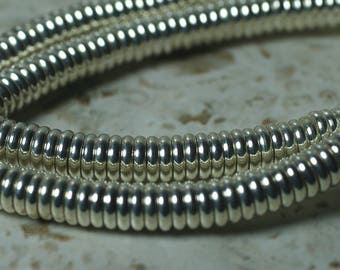 Silver tone rondelle beads aprox 6mm in diameter 2mm thick hole size aprox 1mm, 50 pcs (item ID FA2467MB)