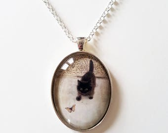 Kitten with Butterfly, 30x40mm oval pendant in silver or antique bronze, includes complimentary chain