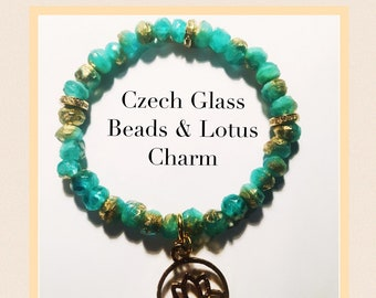 Lotus Charm Czech Glass 8mm Beaded Blue and Gold Bracelet
