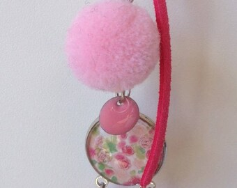 Pink bag with tassel, cabochon and leaf