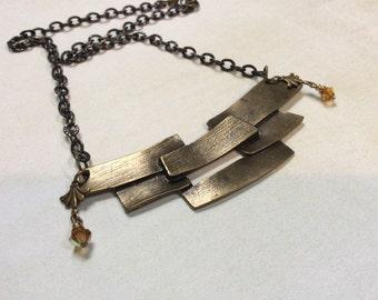 Antiqued bronze abstract pendant. Brick pattern pendant. Amber swarovski crystals. Art deco findings.