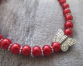 red beaded and silver spacer detail butterfly bracelet
