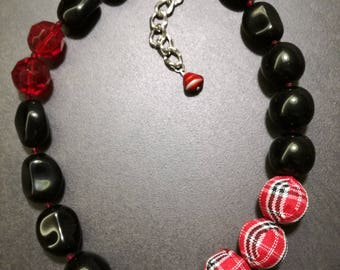 Black and red choker necklace with glass beads and fabric