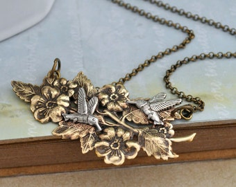 HUMMING BIRD and flower necklace in antiqued silver and brass