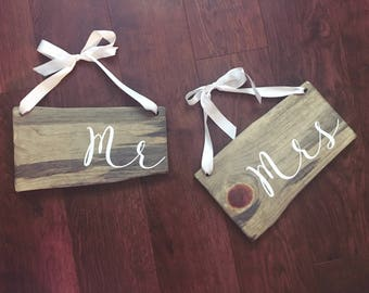 Hanging Mr and Mrs chair signs