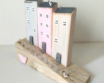 Cottages/houses/harbour made from driftwood and other reclaimed materials and beach finds