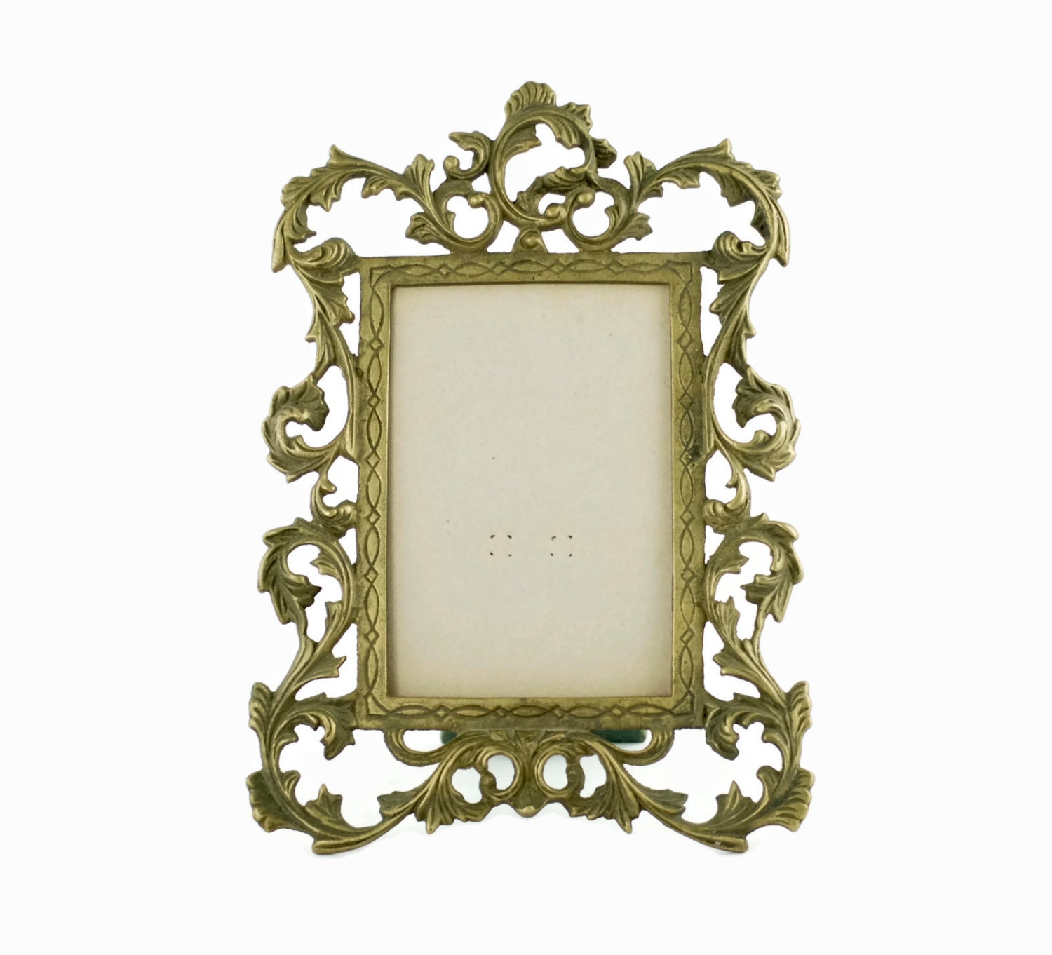 Vintage brass rococo style tabletop picture frame with description this ornate brass tabletop frame jeuxipadfo Choice Image