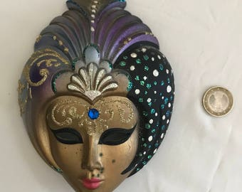 Venetian mask in the shape of a native woman ceramic
