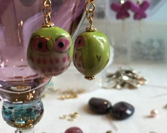 Cute green owl earrings with pink accents