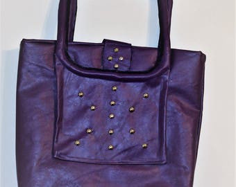 Purple studded faux leather handbag