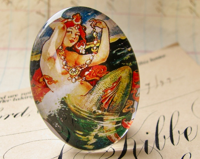 From our Magical Maidens collection, vintage mermaid comic illustration, red hair, 40x30mm glass oval cabochon, handmade in this shop