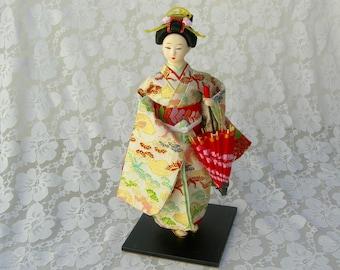 "Japanese Geisha Doll (Ningyo), gold silk brocade kimono, fancy hair style, hand-painted face, traditional paper umbrella, 12"""