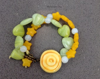Joyful Bracelet: Ceramic bullseye, Pressed Glass, Antiqued Brass