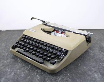 Vintage Antares compact two-tone typewriter