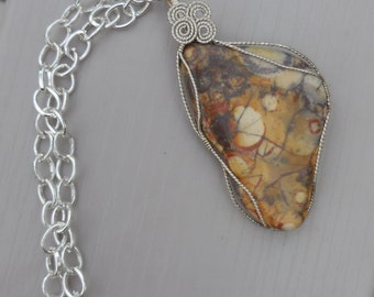 Large Three-sided Beast of a pendant, wrapped in sterling silver