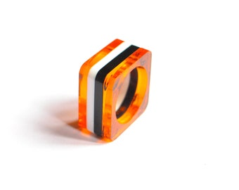 Black, white and orange stripes ring. Lucite ring. Laser cut. Plastic ring. contemporary. Perspex, plexiglas
