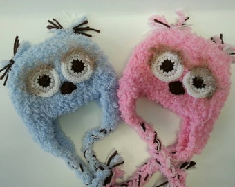 Crocheted twin owl hats for boy and girl.