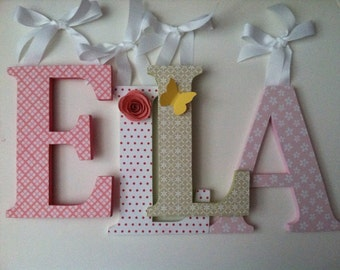 Wooden  letters for nursery spelling out your child's name  in pink and green