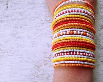 Orange summer bracelet of beads Orange bracelet with ornament Bracelet on wire with memory Bright summer bracelet Wide orange bracelet