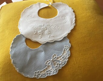 Bibs made by hand on linen one in point carving and with floral motifs and bows, the other to point