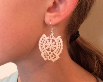 White vintage lace on an antiqued bronze hook