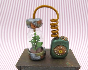 Steampunk hydroponic with power unit and faux brass hose in 1:12 scale