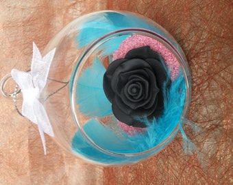 Decorative black rose with feathers
