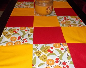 Table runner patchwork  approx 15 x 35 Red and goldenrod with flowers reversible.