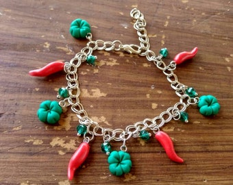 Bracelet with Lucky charms, four-leaf clover, Fimo Red cornet