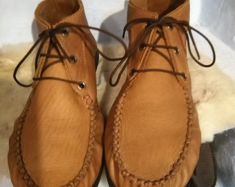 Moccasins style shoe .