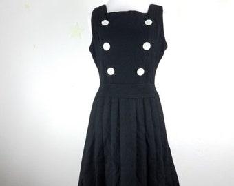 on sale vintage black wool dress 1960s madmen MOD style designer Josette fit flare box pleat button embellishments square neckline