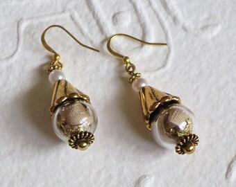 fancy beige color earrings